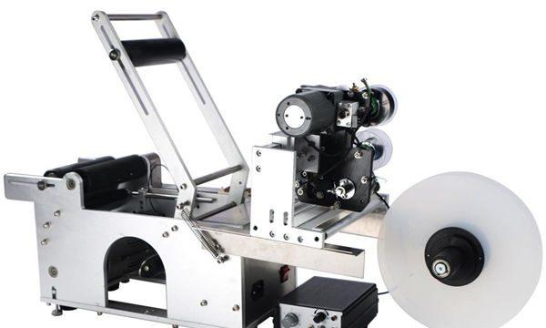 Poloautomatický stroj na etiketování kulatých lahví